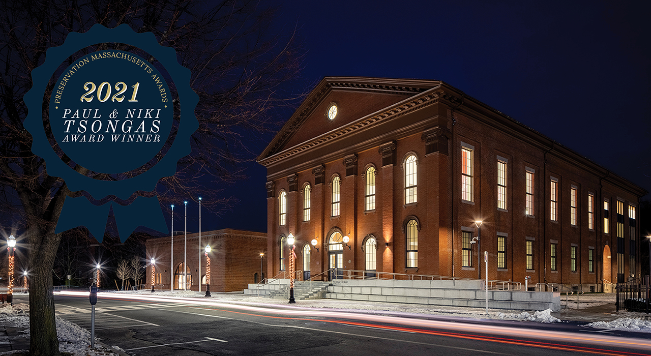 Night shot of Fitchburg City Hall with a seal for the Preservation Massachusetts Paul and Niki Tsongas award; Photographer Trent Bell